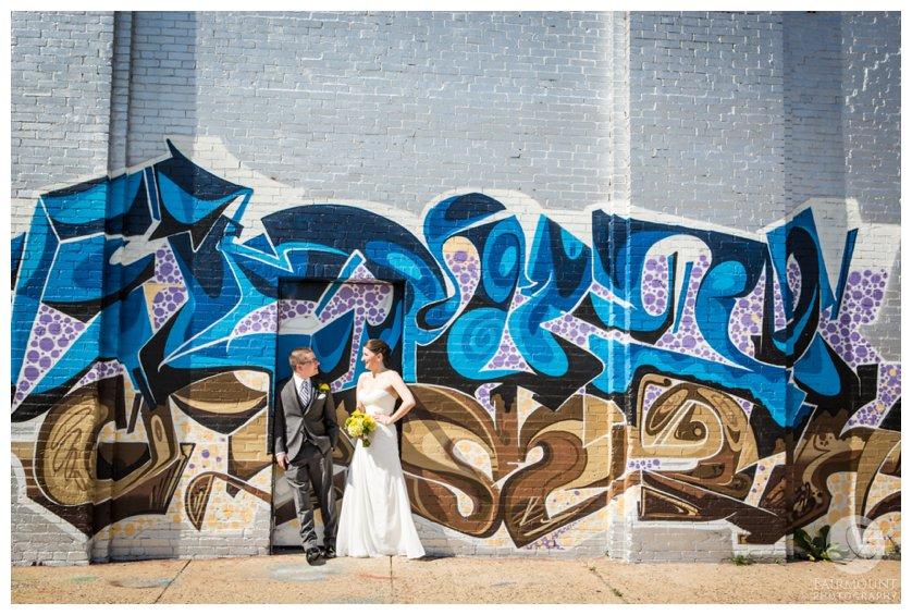 Bride & groom near grafitti wall in North Philadelphia