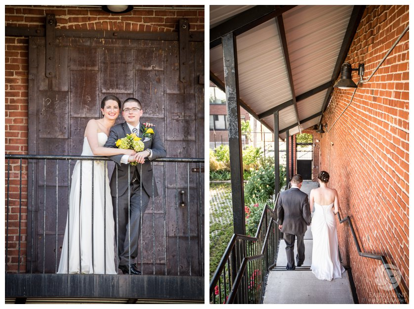 Bride and groom on stairs of old factory in North Philadelphia