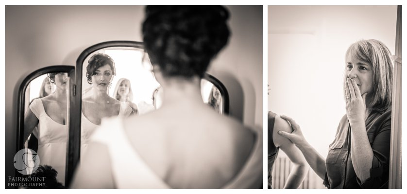 mother of the bride looks on as bride checks herself out in the mirror