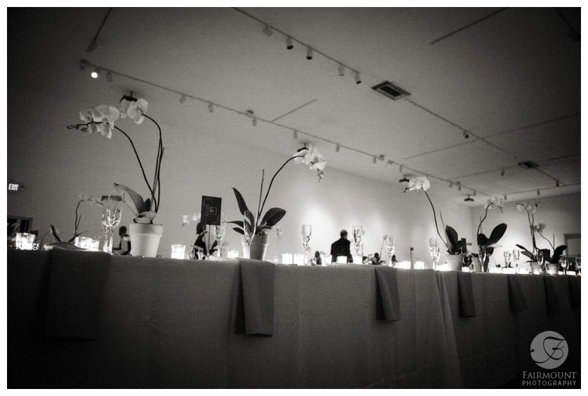 long tables at reception with orchid centerpieces
