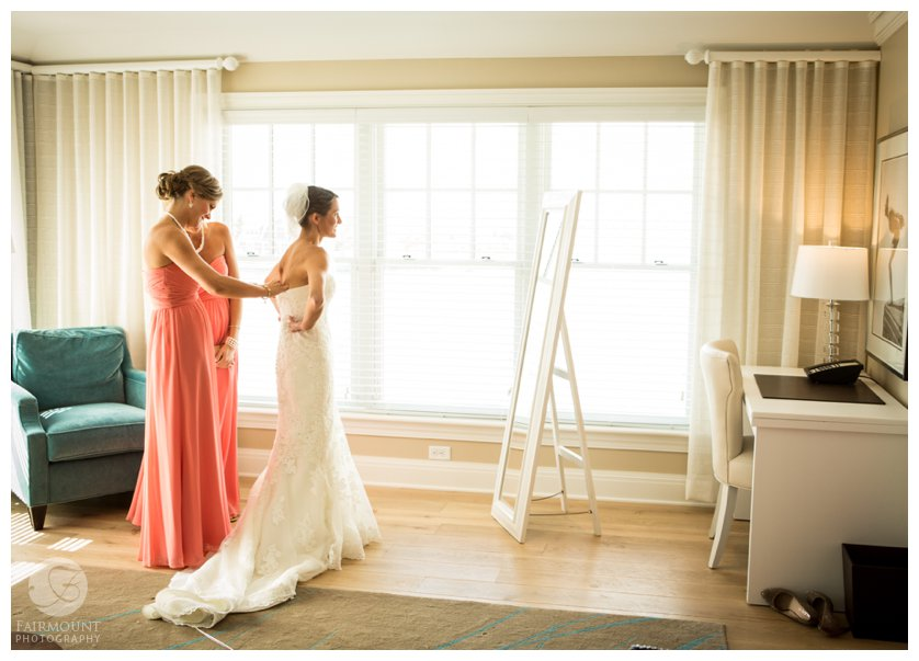 bride puts on wedding dress at The Reeds at Shelter Haven, a luxury boutique hotel