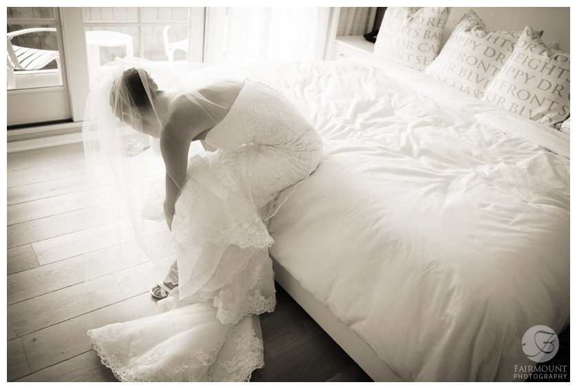 elegant black & white portrait of bride getting ready