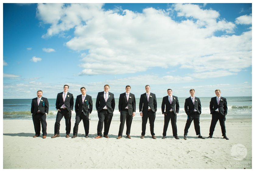 groomsmen in front of the ocean at beach wedding