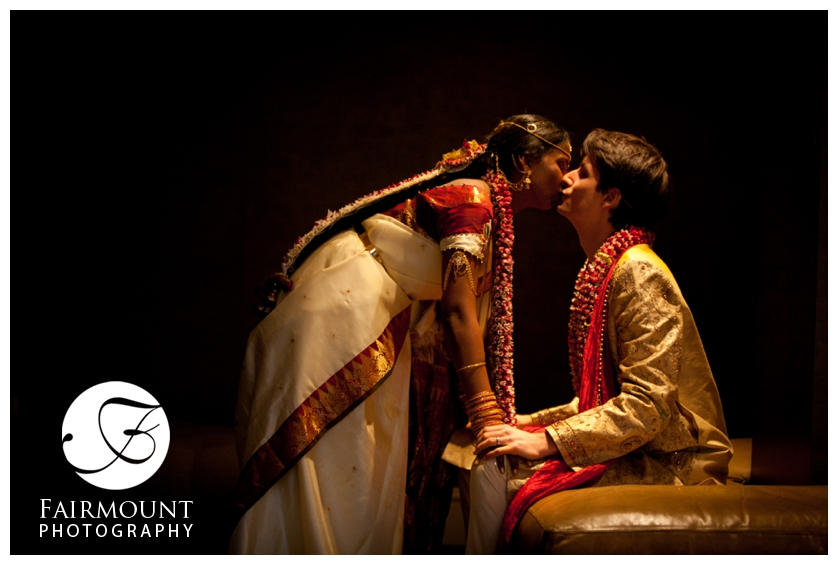 Indian Bride and Caucasian Groom kiss