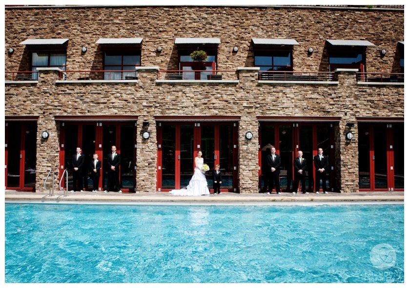 Bride and groomsmen by pool at Bear Creek Resort