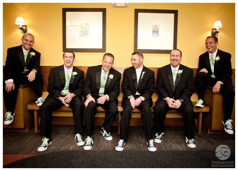 groomsmen wearing chucks with suits