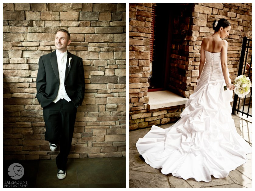 bride & groom in front of stone wall at Bear Creek