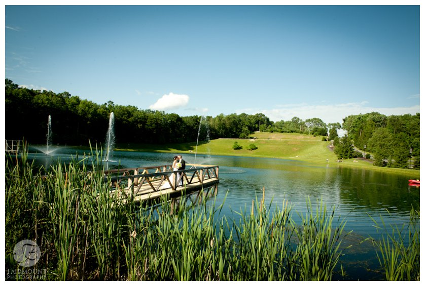 bride and groom on dock over lake in Lehigh Valley wedding photography
