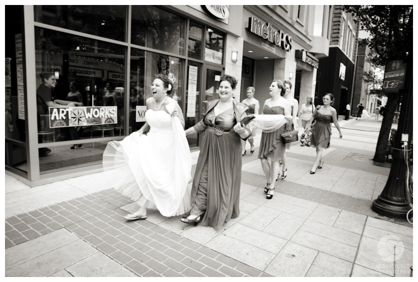 bride & bridesmaids walk through city to wedding