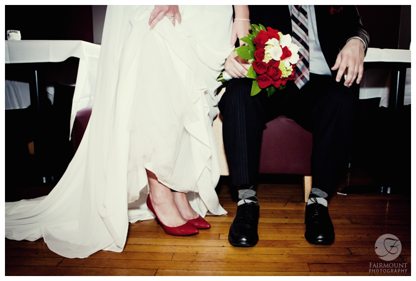 bride's red wedding shoes, groom's argyle socks