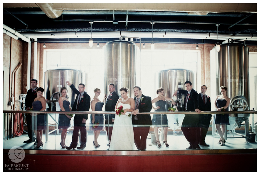 Bridal party portrait in front of beer casks at Brew Works in Allentown, PA
