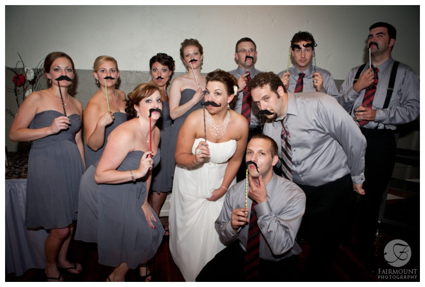 wedding party with moustache props