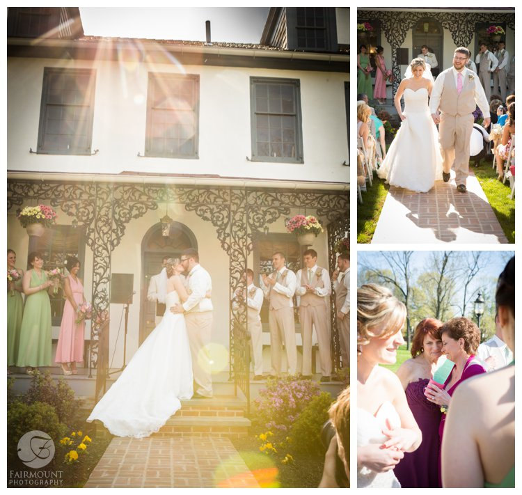 First kiss at April wedding ceremony at old farmhouse