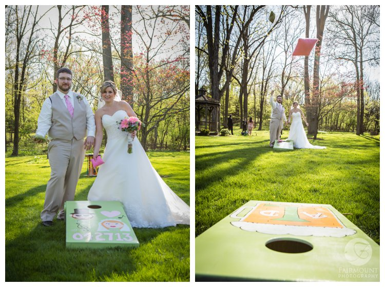 bride & groom with homemade Cornhole boards