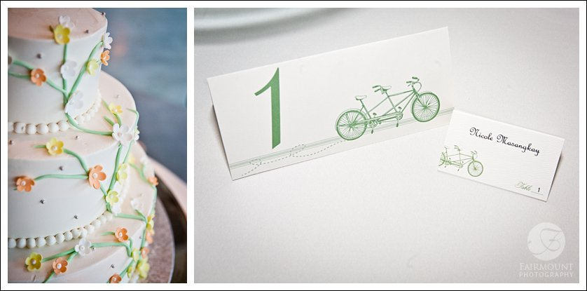 wedding cake with small yellow and orange flowers, table numbers and placecards with bicycle details