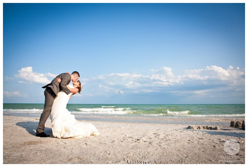 groom dips bride for a portrait on the beach at a destination wedding in Sanibel Island, FL