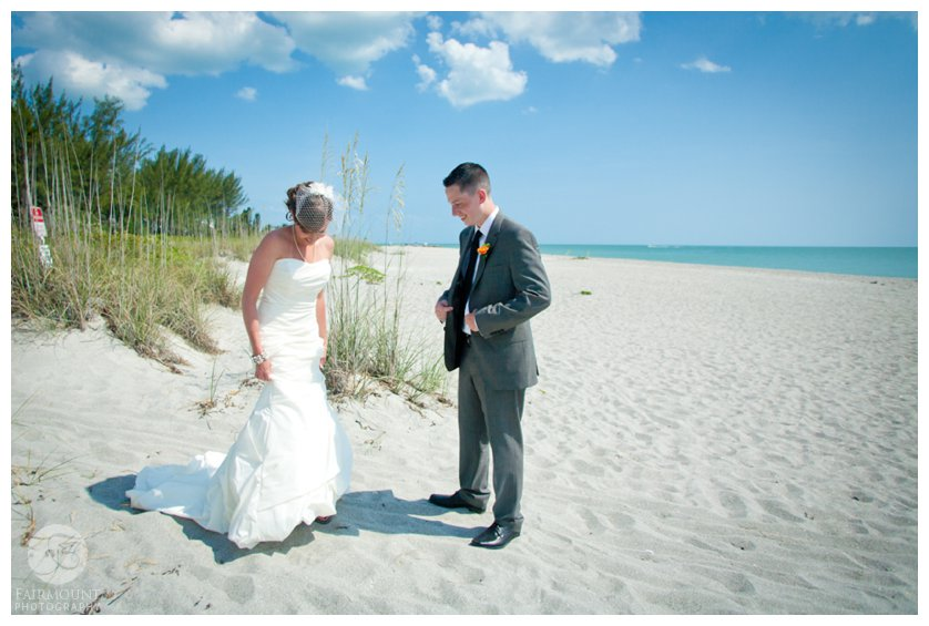 white sand, turquoise ocean and a beautiful bride and groom at beach first look