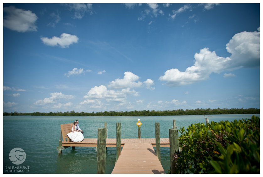 bride and groom on dock in bay in Captiva, FL