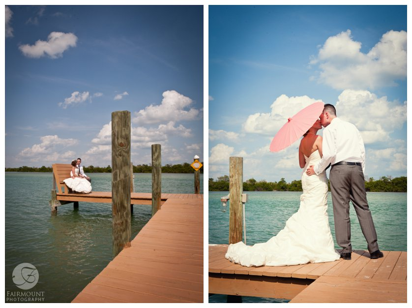 bride and groom kiss under a coral parasol on the dock leading to the bay off Captiva Island