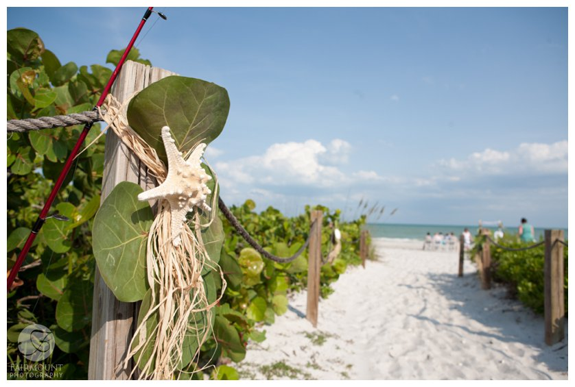 sea grape leaves and starfish decorate path to beach wedding in South Florida