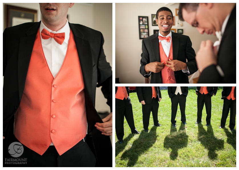 groomsmen with orange vests and bowties