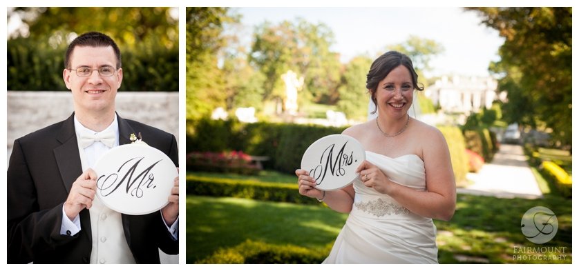 bride & groom holding Mr. & Mrs. signs