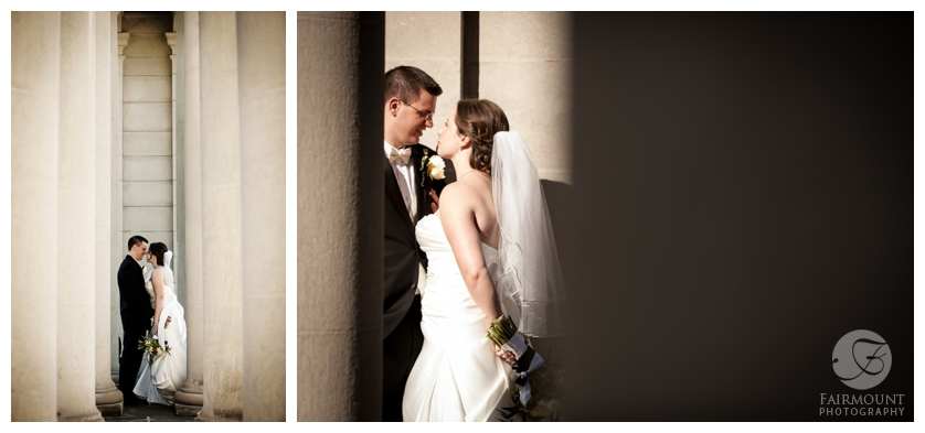 Bride & Groom kiss between columns at Nemours Mansion in Delaware