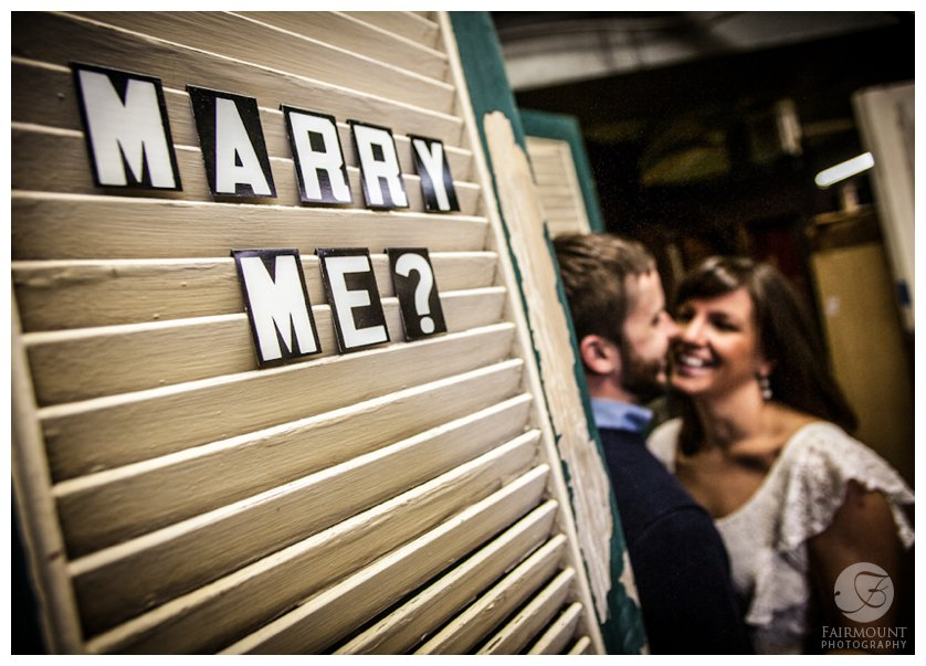 Marry me sign in engagement portrait at ReStore in Philadelphia, PA