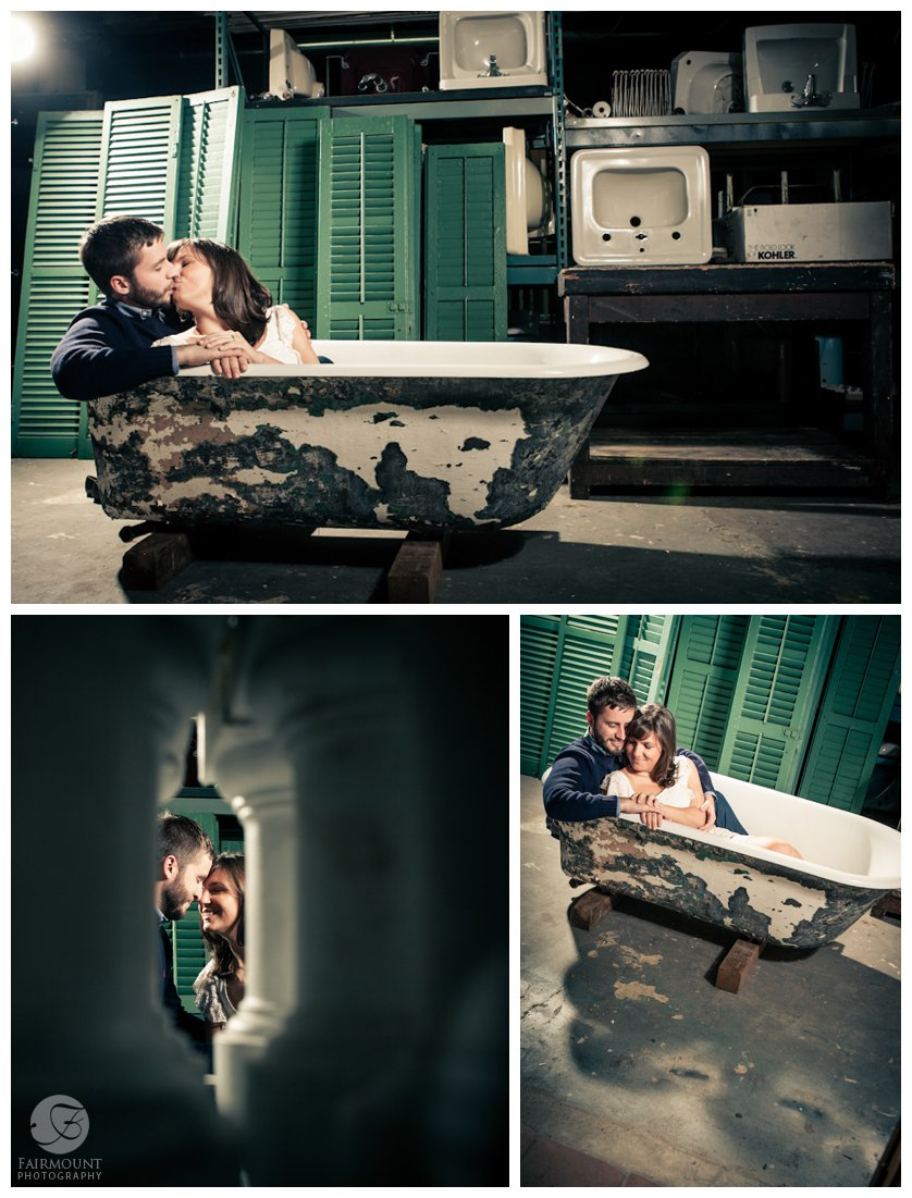 couple kisses in clawfoot tub at restore, a used furniture store in Fishtown