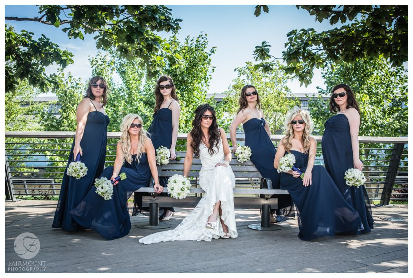 bridesmaids wearing sunglasses on Race Street Pier