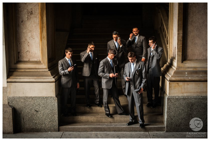 groomsmen on cell phones