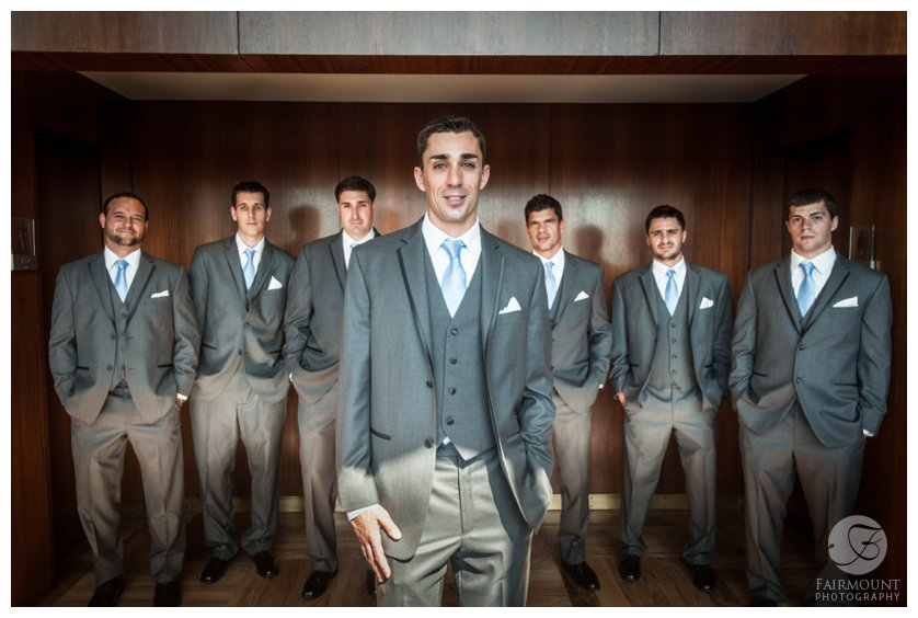 groomsmen wearing charcoal suits with pale blue ties