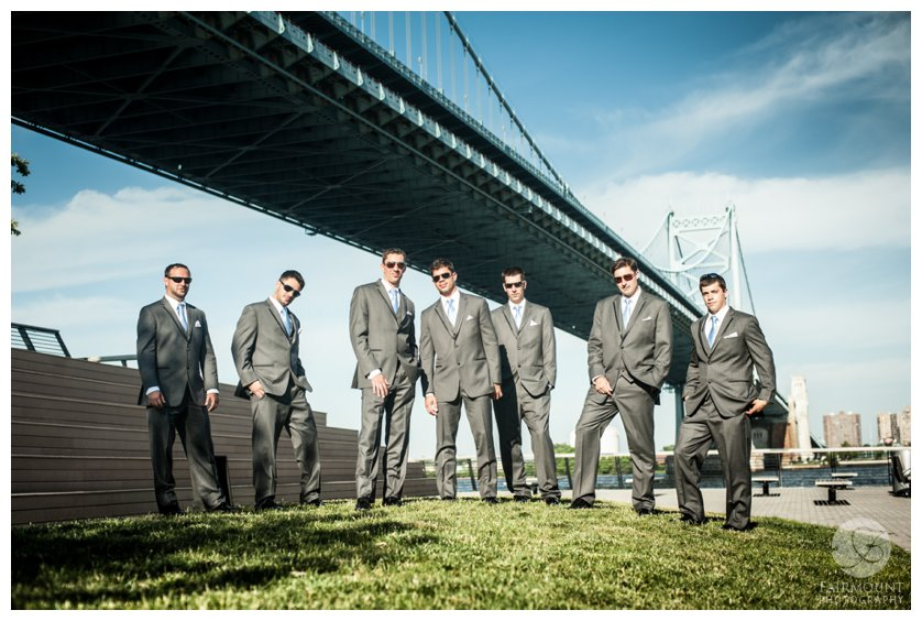 groomsmen under the Ben Franklin Bridge at Race Street Pier