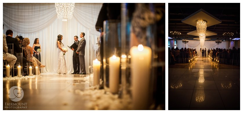 pillar candles and white rose petals line the aisle during a wedding at Tendenza in Philadelphia