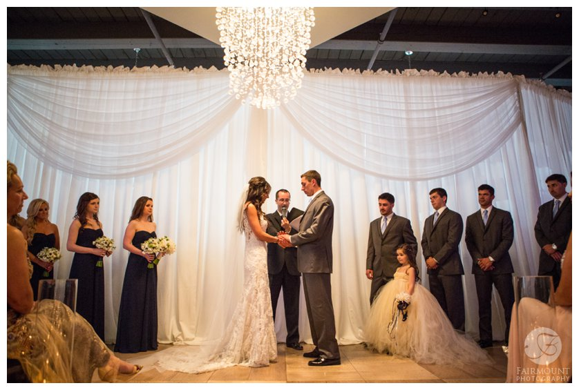 elegant wedding ceremony under crystal chandelier