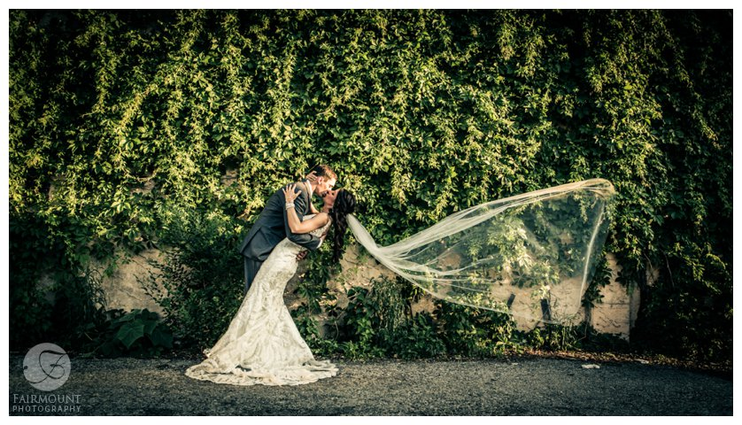 dramatic bridal portrait with long veil blowing in the wind