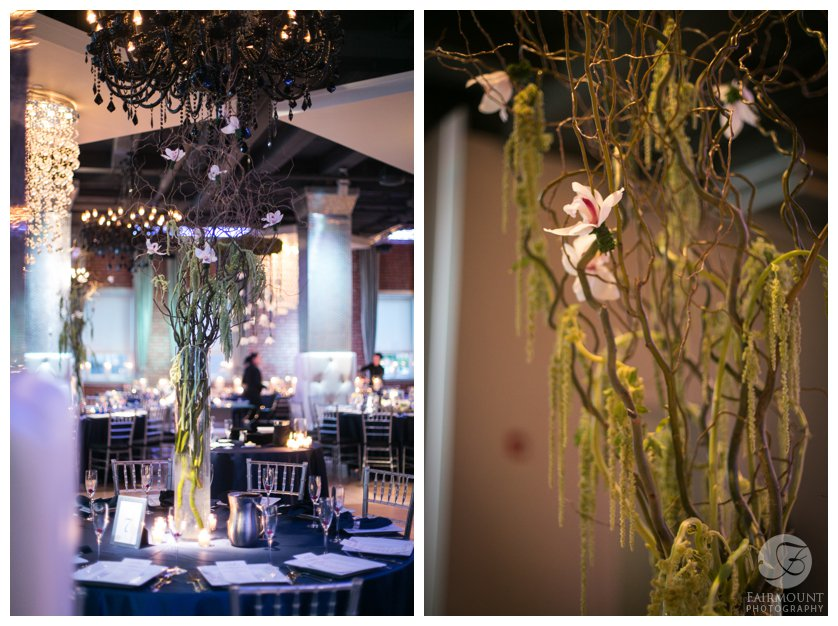 dramatic tall centerpieces with curly willow, orchids and hanging moss