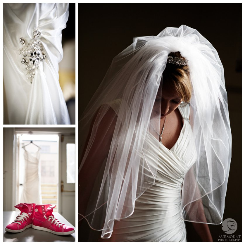 bride's pink sneakers with wedding gown, bride looking down with beautiful lighting on veil and dress
