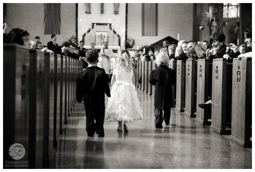 ringbearers and flowergirl walk down the aisle