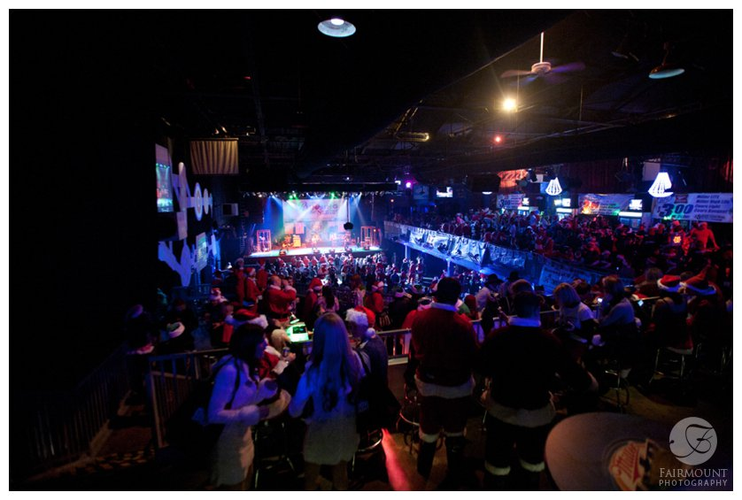 A crowd of people dressed as Santa waits for concert to start at Electric Factory in Philadelphia, PA