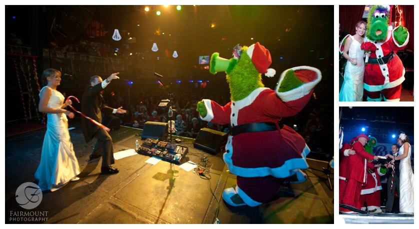 The Phillie Phanatic dressed as Santa joins the newlyweds on stage at the Running of the Santas