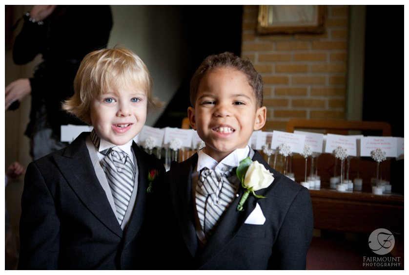 Two ringbearers with gray-striped cravats smiling before ceremony