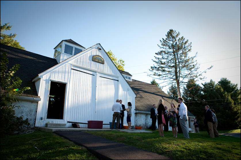 Wedding guests enjoys cocktails outside the barn before the reception in Bethlehem, PA
