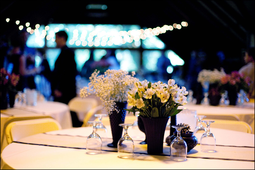 Wedding reception details with yellow flowers and baby's breathe