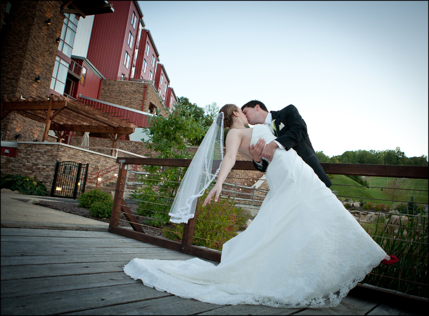 Wedding photo of happily married couple outside The Lodge at Bear Creek Mountain Resort