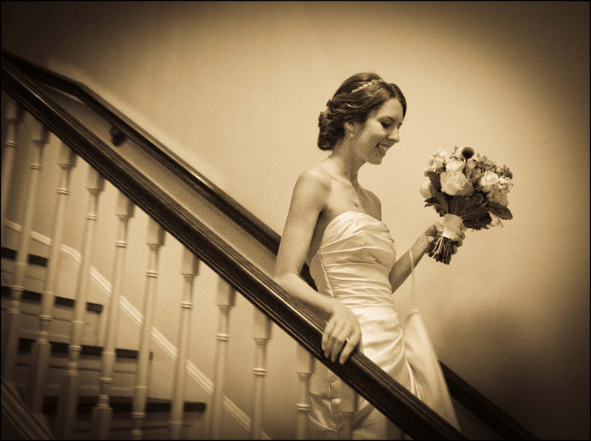 Beautiful bride walks down stairs at the Presbyterian Church of Chestnut Hill