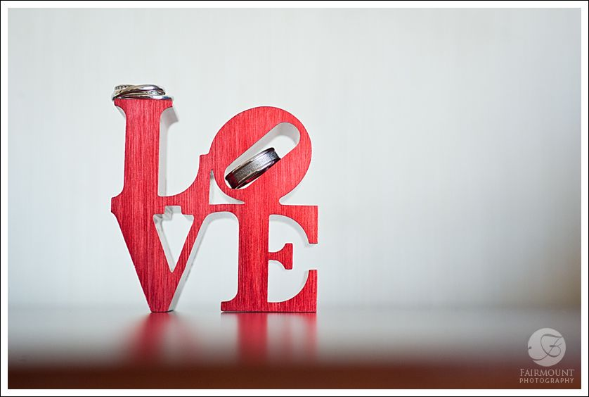 Miniature LOVE statue with wedding rings