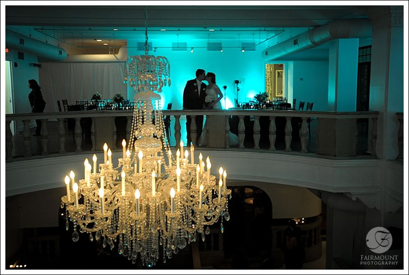 Chandelier with silhouette of bride and groom in the background