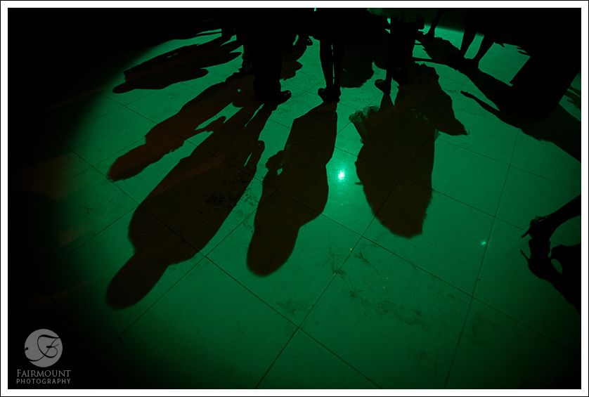 Shadows on dance floor with green lighting