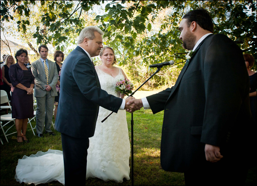 Bethlehem, Pennsylvania wedding ceremony starts as the father of the bride shakes the grooms' hand